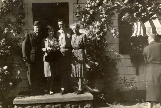 Dorrie in the middle, with flowers. No clue who these other folks are.