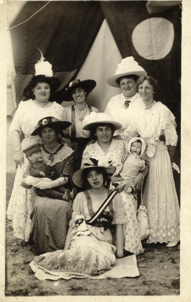 Great-great-grandmother Fanny is in the back row on the left, and great-grandmother Margaret is in the front with her tongue out. Date and photographer unknown. I am wild about the hats.