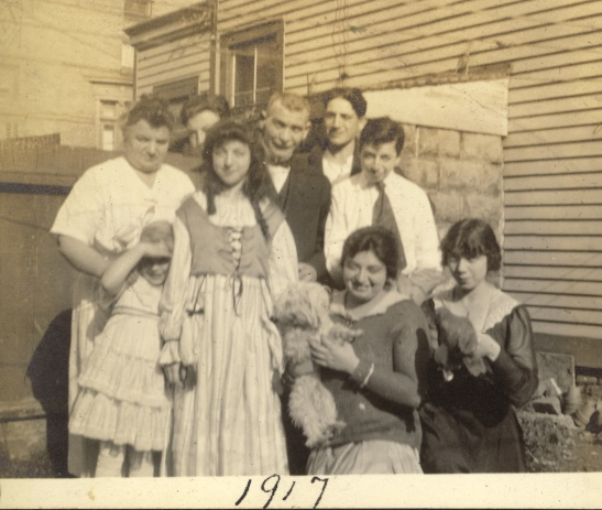 This the Spielmann family, 1917. One son--possibly Erwin--is missing from this picture. Leonor peeks out from behind Fanny. Photographer unknown.