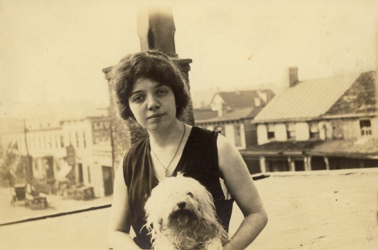 "Great-grandmother Margaret, date, location, and photographer unknown. Other photos identify the little white dog as ""Tootsie"""