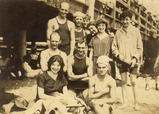 A happy crew at the beach. Great-grandmother Margaret in black in the front row, Lillian in stripes, and Hilda peeking out from behind. Date, location, and photographer unknown.