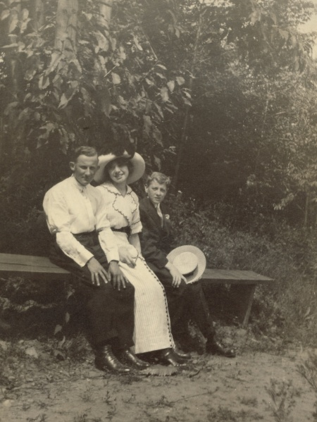 "Back of the photograph: ""Martin, Myself, and Court at Bellwood Park, June 30, 1912"""
