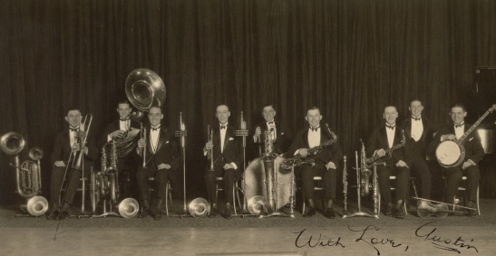 "On front: ""With love, Austin"" On back, in Mama Helen's handwriting: ""George Olson's band, 1920 New York. Austin F. Yoder 4th from the right, with saxophone. George Olson, in center."