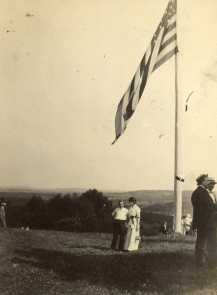 "The back of the photograph says, ""The flag, Martin, and myself. Bellwood Park, June 30, 1912."""