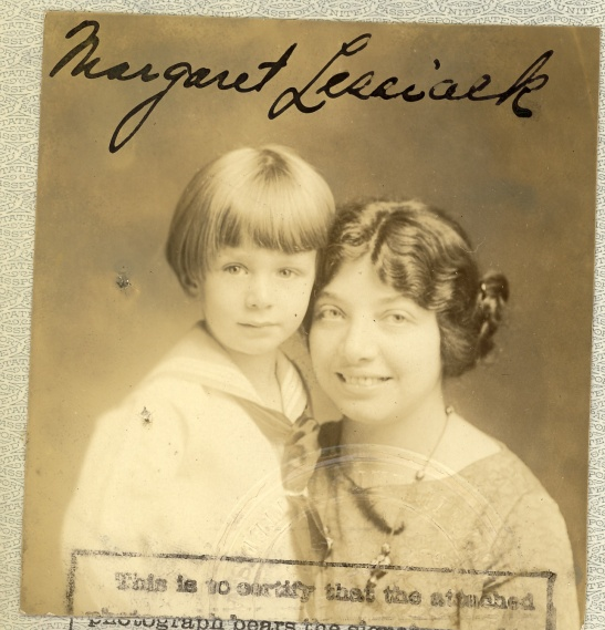 A lovely passport photo from back when kids didn't need their own passports.
